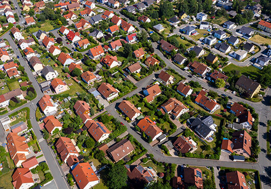 Aerial view above suburb houses