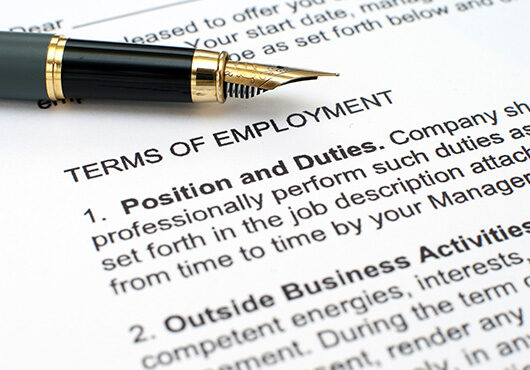 Close up of employment contract and pen
