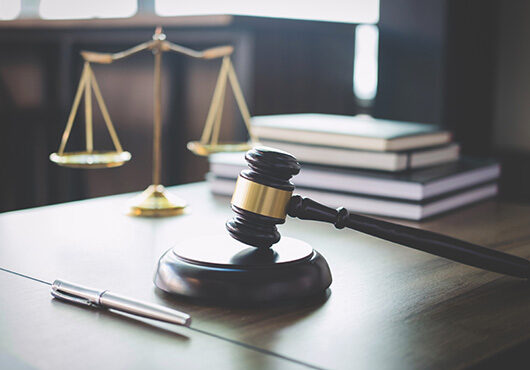 Scales of justice and Gavel on wooden table