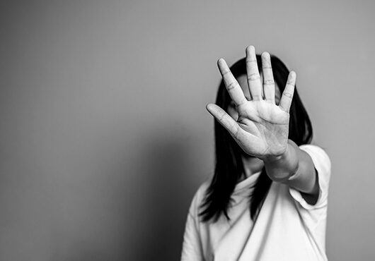 Woman raised her hand for dissuade